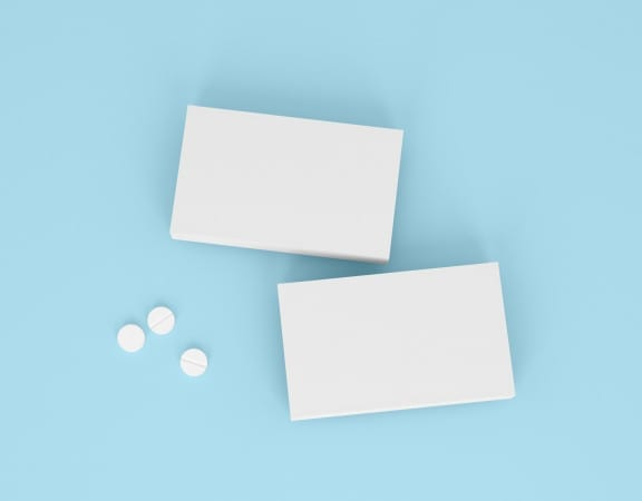 Two boxes of pills on the blue background. Pharmacy mockups for meds presentations, BADs and other kinds of pharmaceutical products. Top view.